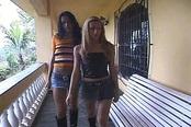 Juliana Nogueira and Karol double team a hard Cock
